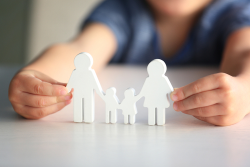 child holding up family image